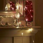 Aurglow guirlande lumineuse pour Noël de 5m extérieure et résistante à l'eau, alimentée par piles avec câble invisible et 50 micro LED – Blanc Chaud de la marque Auraglow image 2 produit