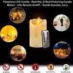 Lot de 3 bougies LED en cire véritable avec effet de flamme vacillante, fonctionnement à pile, télécommande 10touches et minuterie 24heures Hauteur env. 10/12/15cm Couleur ivoire de la marque JYD image 1 produit
